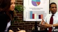 Disabled Businessman Makes Presentation - CU video