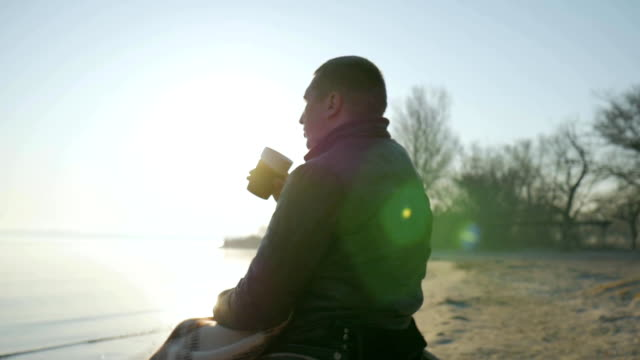 disabled close-up drinks coffee, portrait lonely male cripple on video