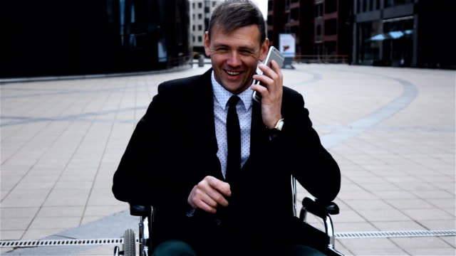 Disabled Invalid businessman talking by smartphone video
