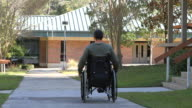 Disabled Man Rolling Away video