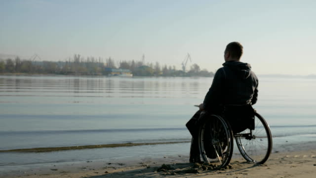 disabled person on wheelchair asks help from God, cripple in wheel video