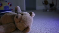 Discarded Teddy bear, child's room. video