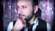 4K Disco Christmas Shot of Man Thinking and Looking at Camara video