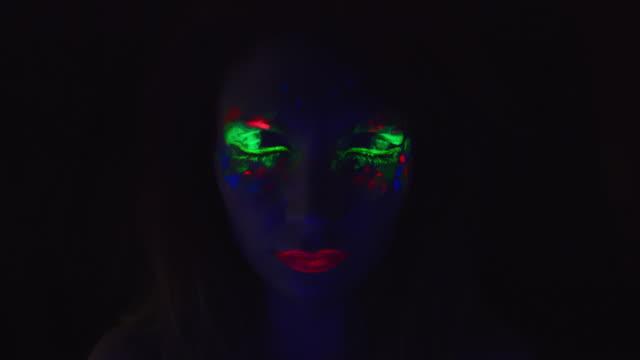 4K Disco Glow Neon Make-up Woman Opening Eyes video