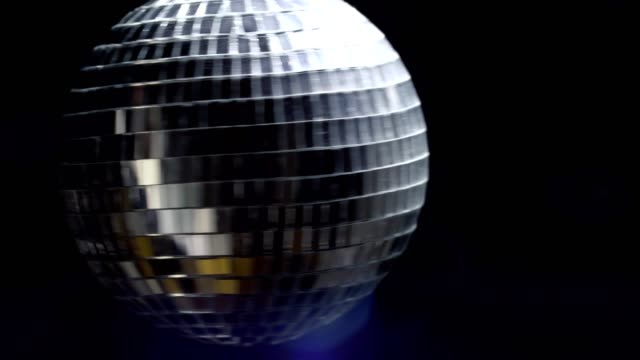 Disco mirror ball at black background with copyspace with glares. 4k UHD video