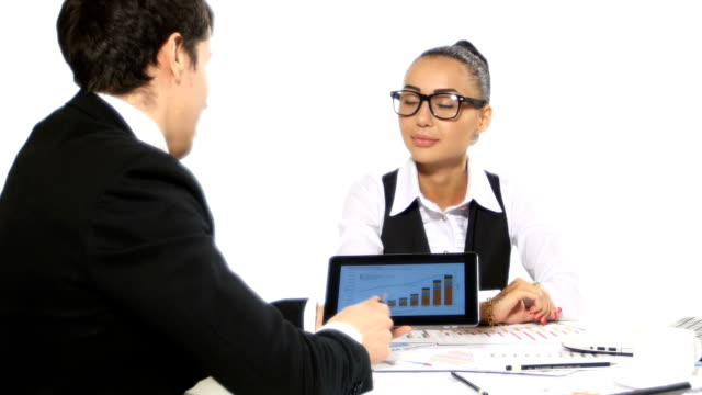 Discussion between a businessman and businesswoman. It shows the graphics tablet, developing a business project and analyzing market data information video