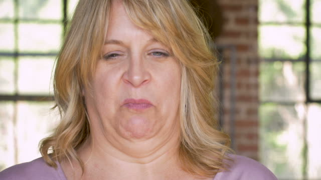 Disgusted or nauseous feeling woman on the verge of vomiting video