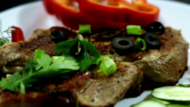 A dish of steak and vegetables video