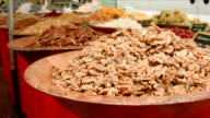 Dish with shelled walnuts at the market video