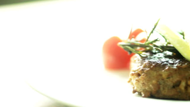 Dishes of Hamburg Steak with some Vegetables on White Plate video