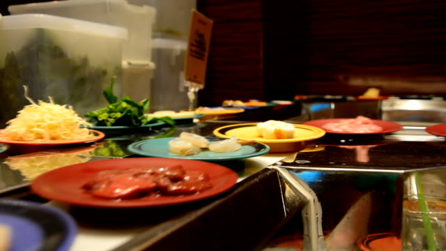 Dishes of ingredients rolling on conveyor belt video