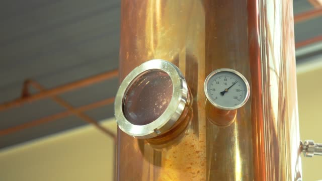 Distilling boiler thermometer and window video