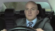 HD: Distracted Businessman Driving The Car video
