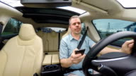 Distracted Driver Annoyed by Constant Text Messages on Smartphone video