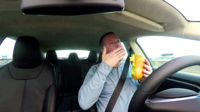 Distracted Driver Eating Lunch while Driving video