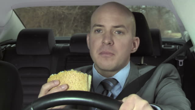HD: Distracted Driver Eating While Driving video