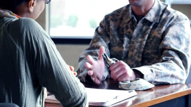 Distressed military veteran talks with psychiatrist video