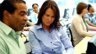 Diverse business professionals attend continuing education training video
