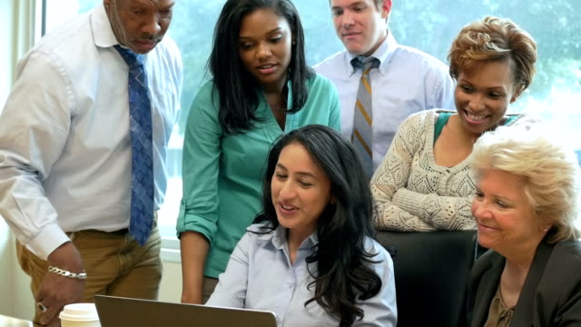 Diverse business team working on project during meeting video