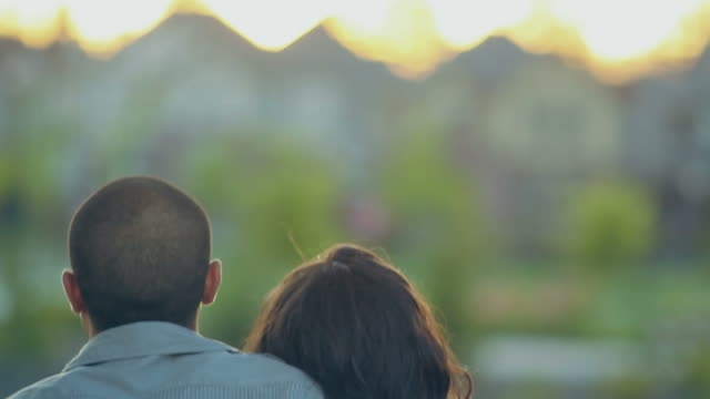Diverse Couple Hugging Looking at Sunset video