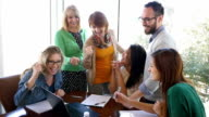 Diverse creative business team celebrating success after accomplishment in board room meeting video