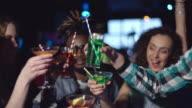 Diverse friends cheering in nightclub video