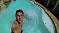 Diverse friends diving into pool and smiling underwater video