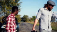 Diverse friends having car trouble walk together video
