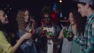 Diverse friends toasting at party video