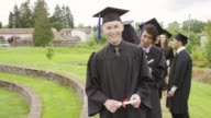 Diverse group of college friends excited after graduation video