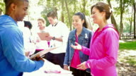 Diverse participants registering for breast cancer awareness race video