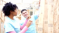 Diverse volunteers building home for charitable organization video