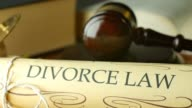 Divorce court law justice litigation concept with gavel and hammer video