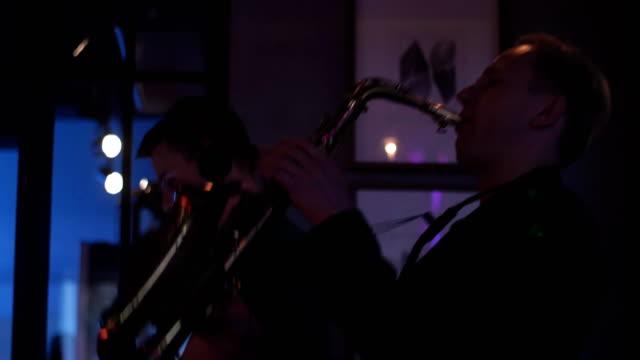 Dj spinning at turntable. Man play saxophone. Party in nightclub. Dancing. Cheer video