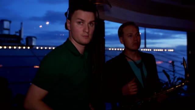 Dj spinning at turntable on party in nightclub. Look in camera. Headphones video