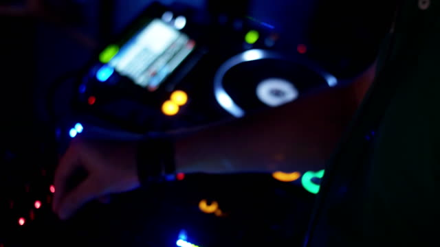 Dj spinning at turntable on party in nightclub. Mixing. Headphones. Lights video
