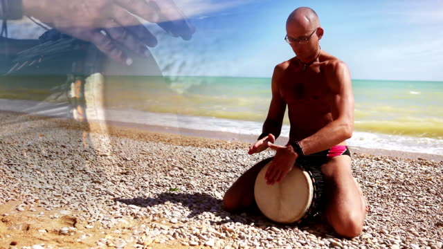 Djembe Drum Player beat rythm on the beach video