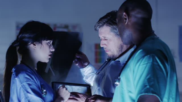 Doctor and nurse or surgeons in meeting video