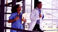 Doctor and nurse running together video