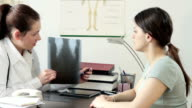 Doctor and patient discussing scan results in diagnostic center video