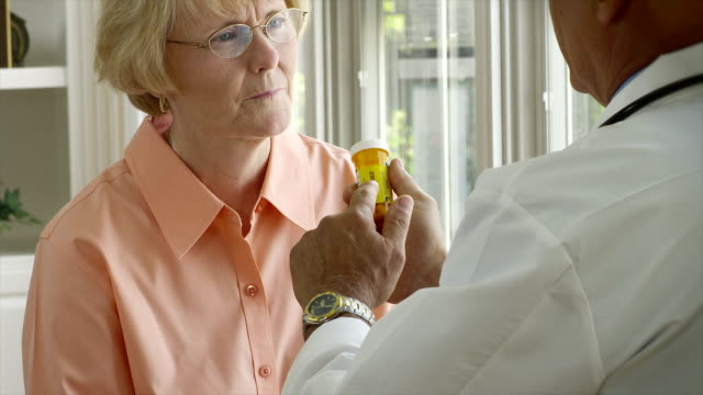 Doctor and patient with prescription video