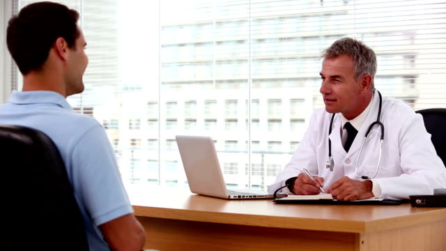 Doctor asking questions to his patient video