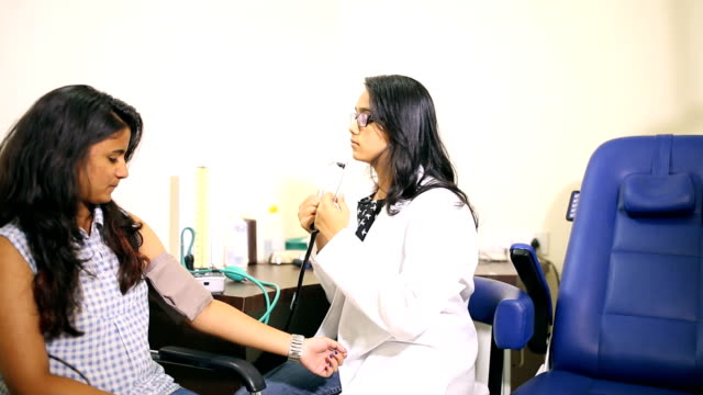 Doctor Checking Blood Pressure video