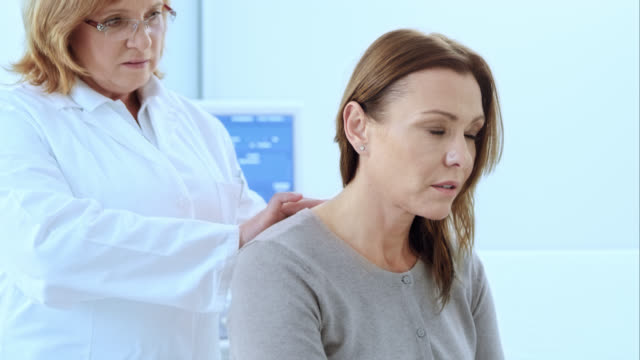 Doctor checking the female patients spine video
