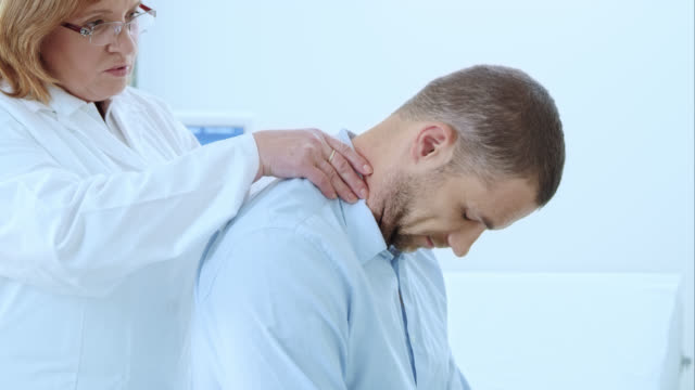 Doctor checking the male patients neck video