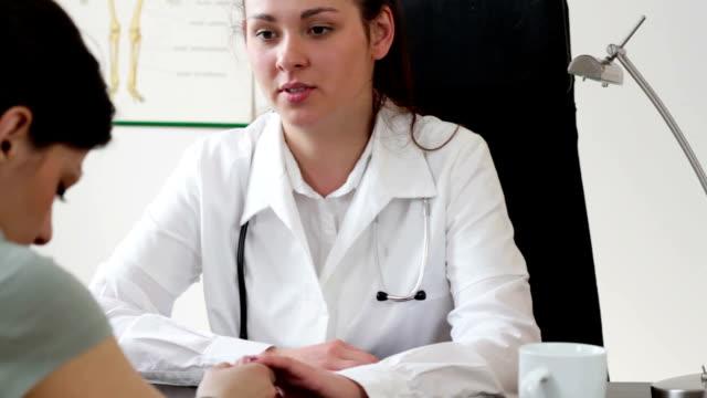 Doctor comfort sad patient, tracking shot video