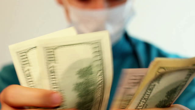 Doctor counting money, corrupt health-care system, insurance video