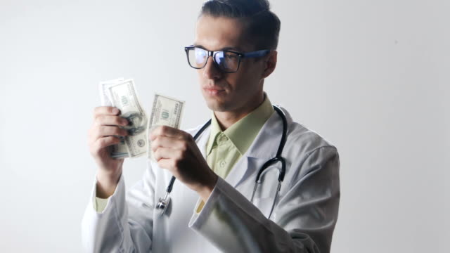 Doctor counts the money. A bribe to a medical worker. Expensive medicine. video