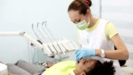 Doctor dentist working with patient in dental clinic video