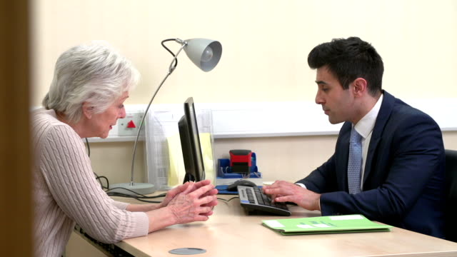 Doctor Discussing Test Results With Senior Female Patient video